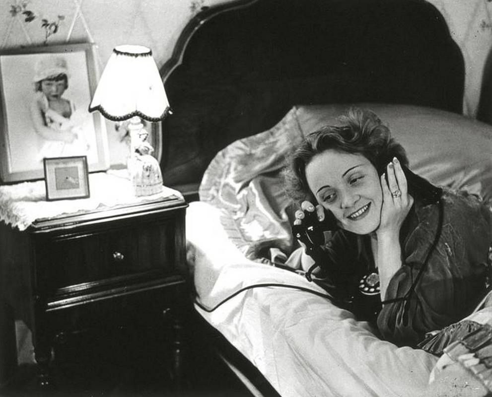 """""""Marlene Dietrich - in Hollywood - telephones her daughter in Berlin""""  Photo: Erich Salomon (1886 - 1944 German Auschwitz concentration camp) USA - California, Los Angeles, 1930"""