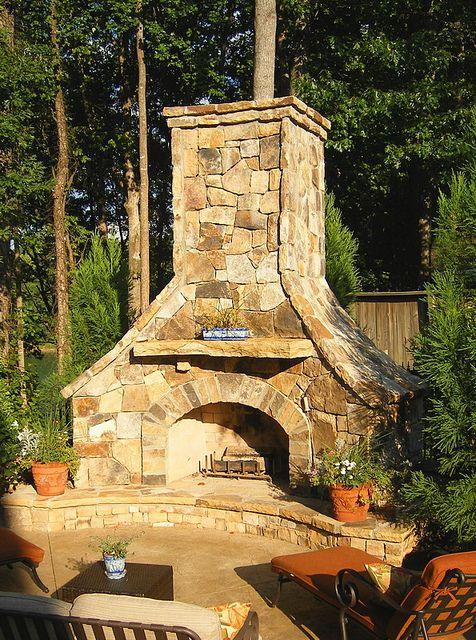 outdoor stacked stone fireplace.   Hearthstone Environments. home@HsEnviro.com, www.HsEnviro.com