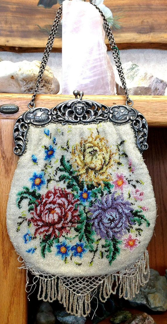Ladies Art Nouveau beaded purse. This purse has an excellent floral design; handle is silver plated with very detailed scenes of farm houses and a cherub face in the center. The purse does have some wear and tear and needs a little work on the fringe. Circa early 1900's $225