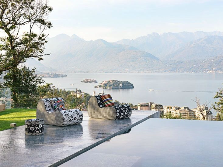 The amazing landscape of Lago Maggiore  enjoyed from a wonderful pool , furniture and towels by MISSONIHOME collection 2015