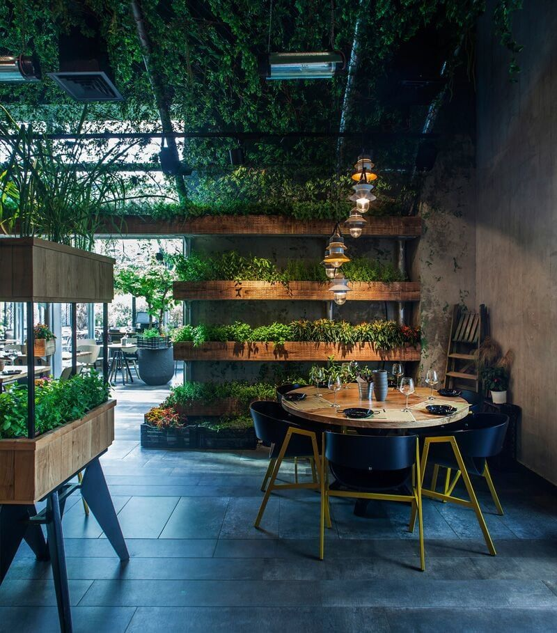 Plant Filled Restaurants Around The World Tips For Decorating With Greenery Greens Restaurant Restaurant Interior Restaurant Interior Design