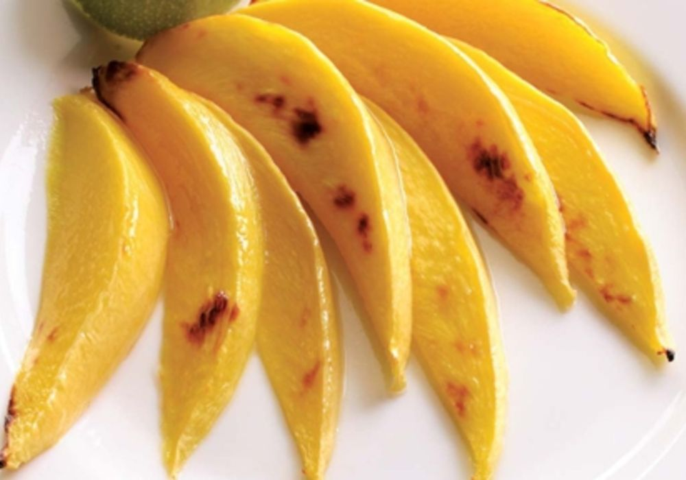 Broiling fruit brings out its inherent sweetness. A squeeze of tart lime juice balances it out. Try this technique with pineapple as well.