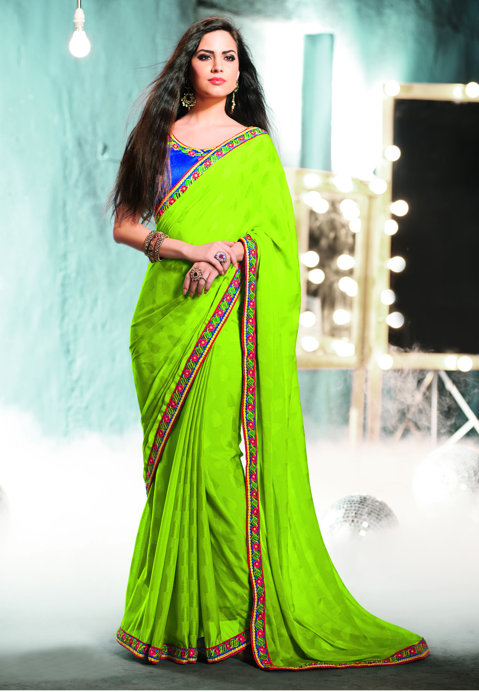 688de51b8fd6b1 parrot green plain with simple traditional border line gives beautiful look  in parties. this #designer #partywearsaree comes with blue simple blouse.