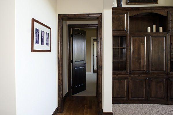 Interior Doors Dark Wood Doors And Trim Accent Beautifully Against Light Colored Walls Bayer Built Woodworks With Images Wood Doors Interior Doors Interior