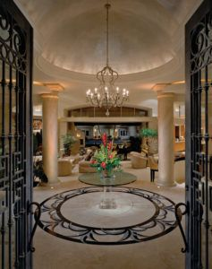 This Tuscaninspired foyer with a mediumsized glass round table