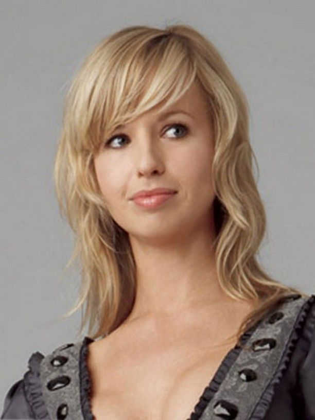 Medium Length Wavy Hairstyle With Layers And Bangs Short And