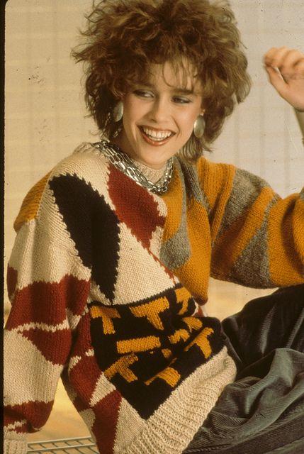 1980's fashion. Model wearing oversized pattern sweater ...