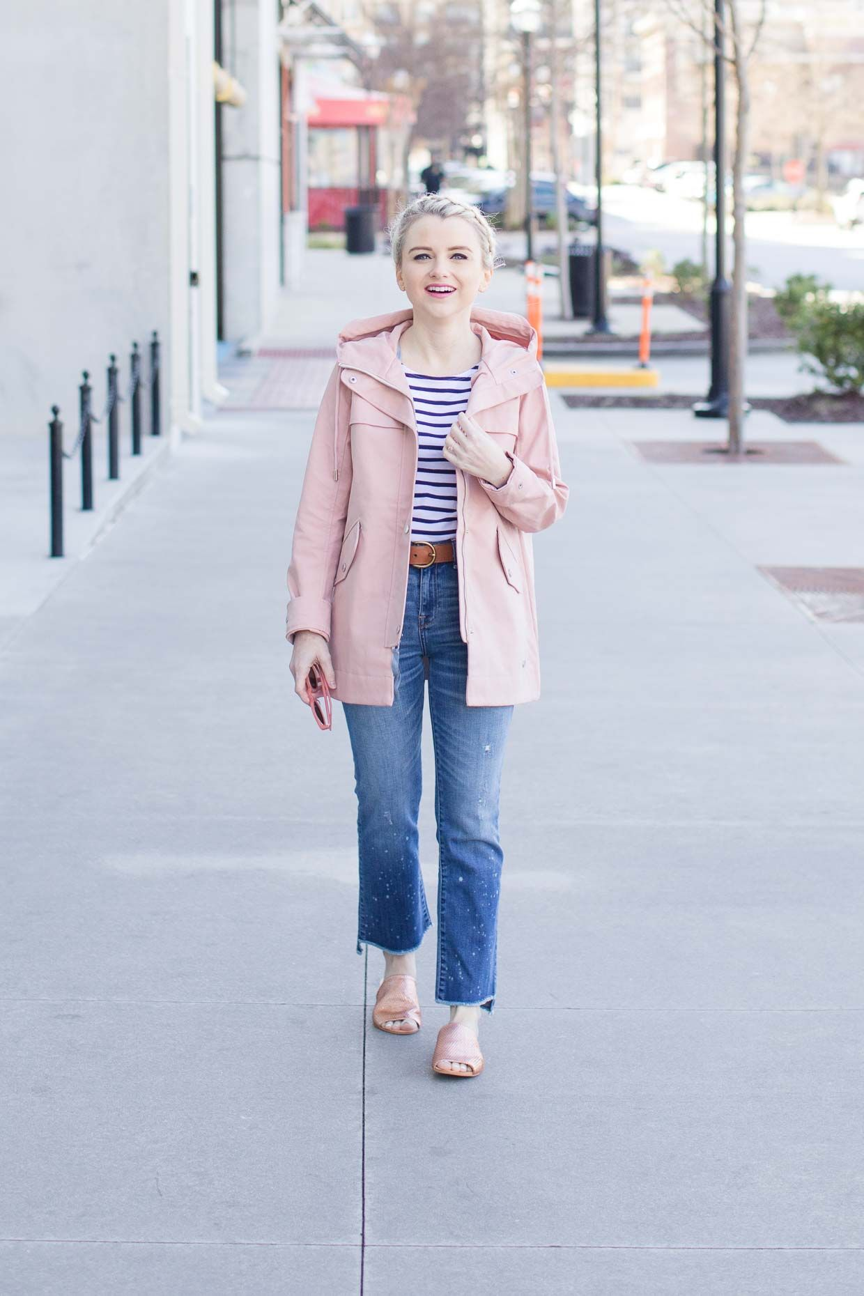 White and navy striped tee+straight cropped jeans+blush slides+blush  raincoat+sunglasses. Spring Casual Outfit 2017