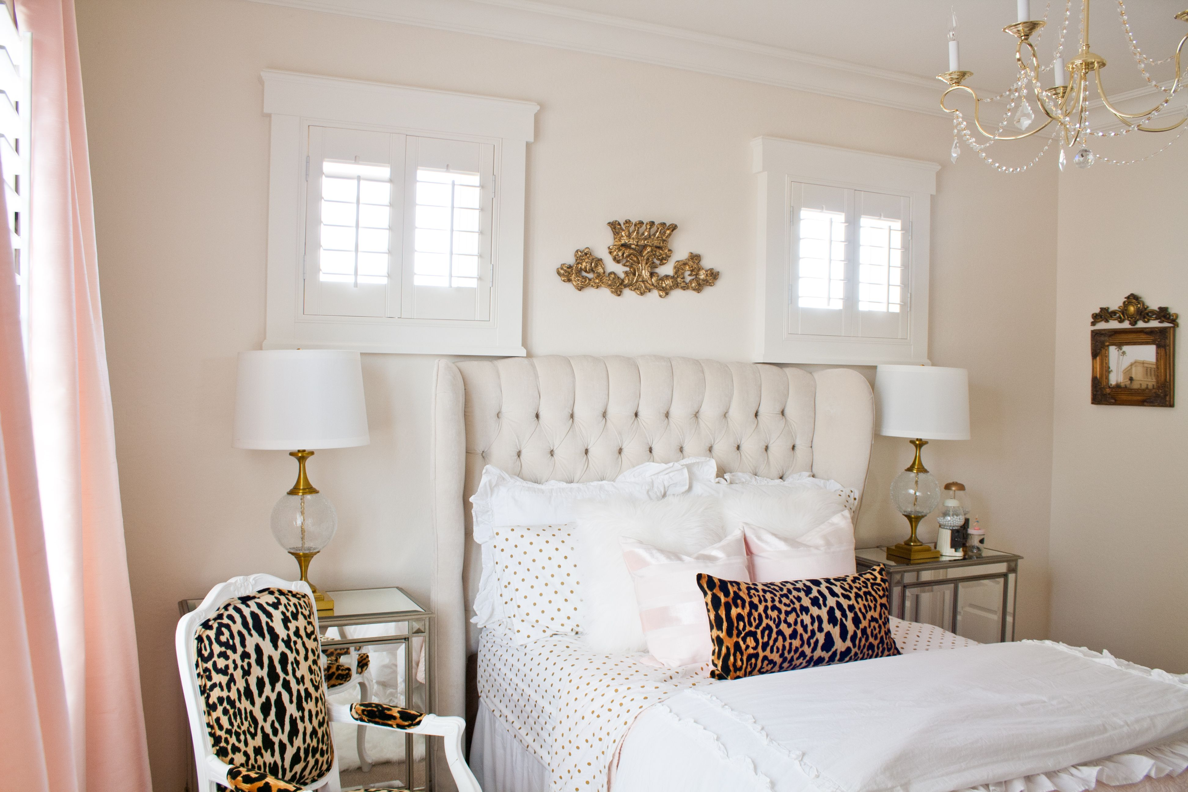 Pink and gold bedroom by Randi Garrett Design with leopard chair