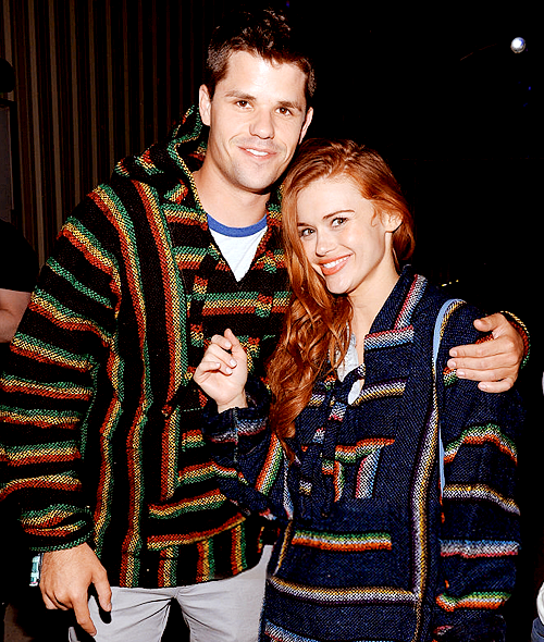 Charlie Carver (Or Max) and Holland Roden attend the Neon Carnival with PacSun, 'Dope the Movie and Tequila Don Julio at the Thermal Hangar on April 11, 2015