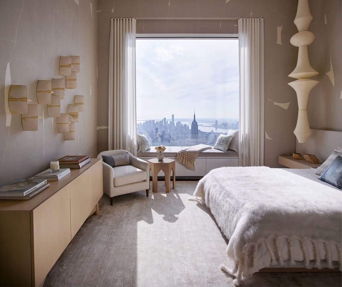 Master bedroom feature wall  One bedroom features wallpaper by Porter Teleo and ceramic works by