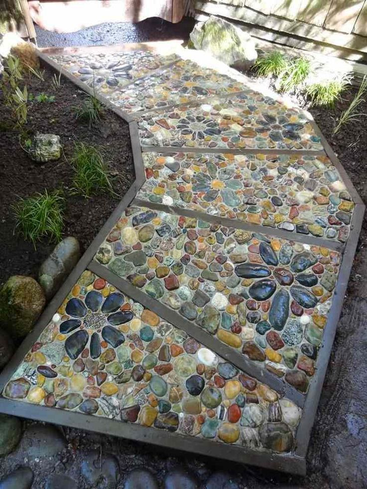 Photo of Driveways garden-mosaic-pebble-colored-flowers – social club