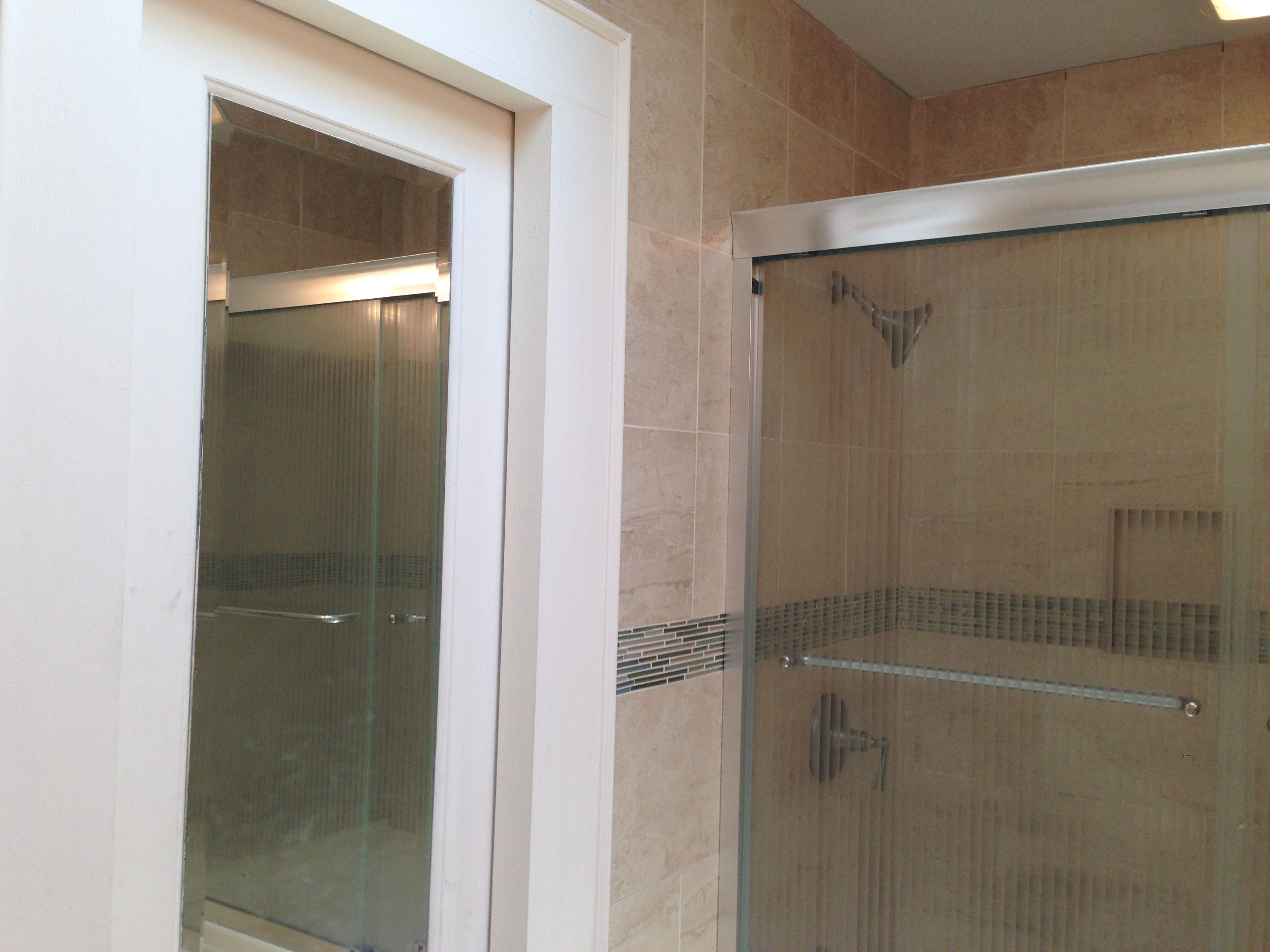 a mirrored pocket door was added to this small bathroom