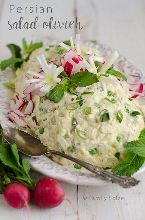 Salad Olivieh is a Persian potato Salad studded with peas, dill pickles, eggs and chicken. It makes a wonderful appetizer or lunch.