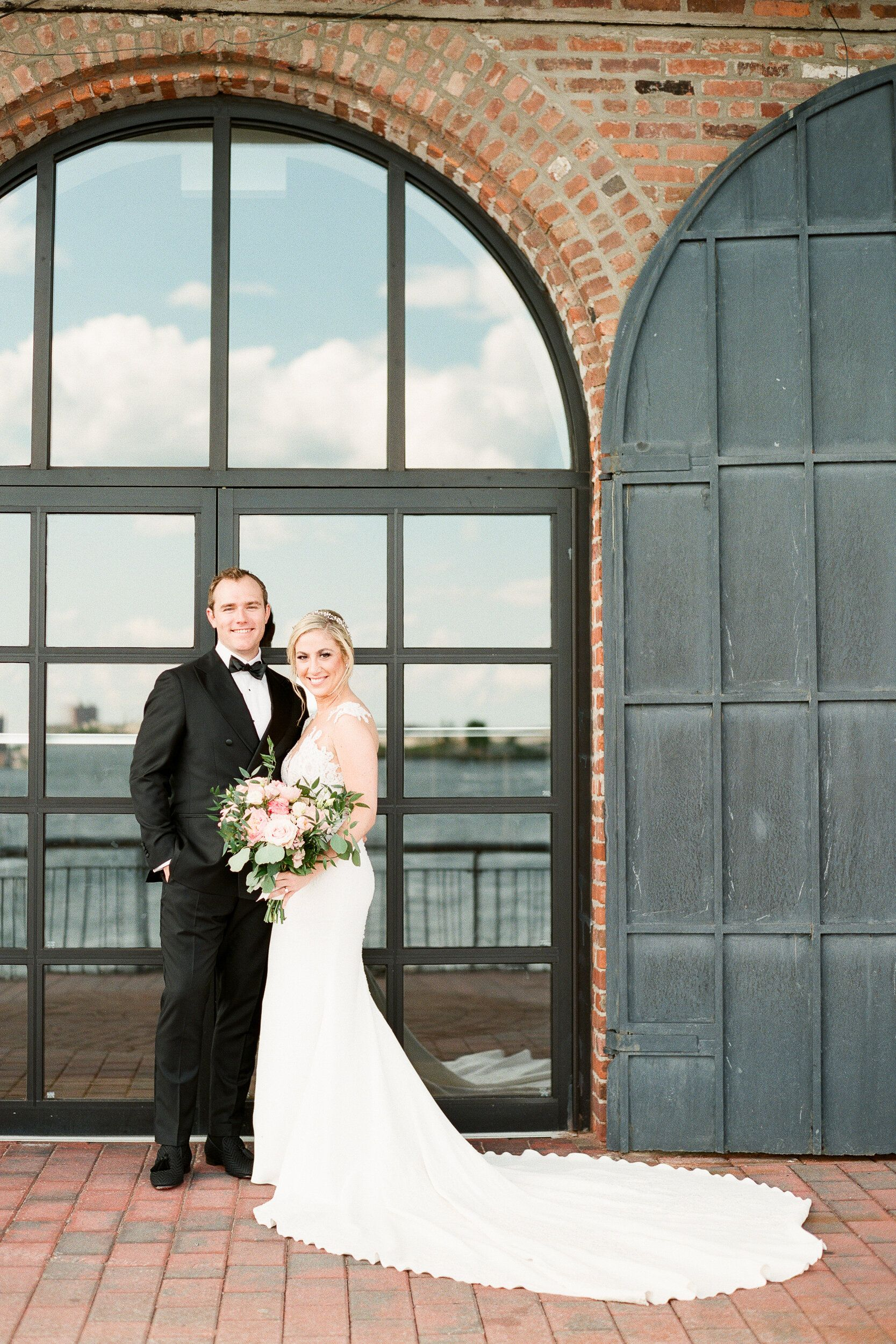 Bride And Groom Wedding Photos In Front Of Glass Doors With Black