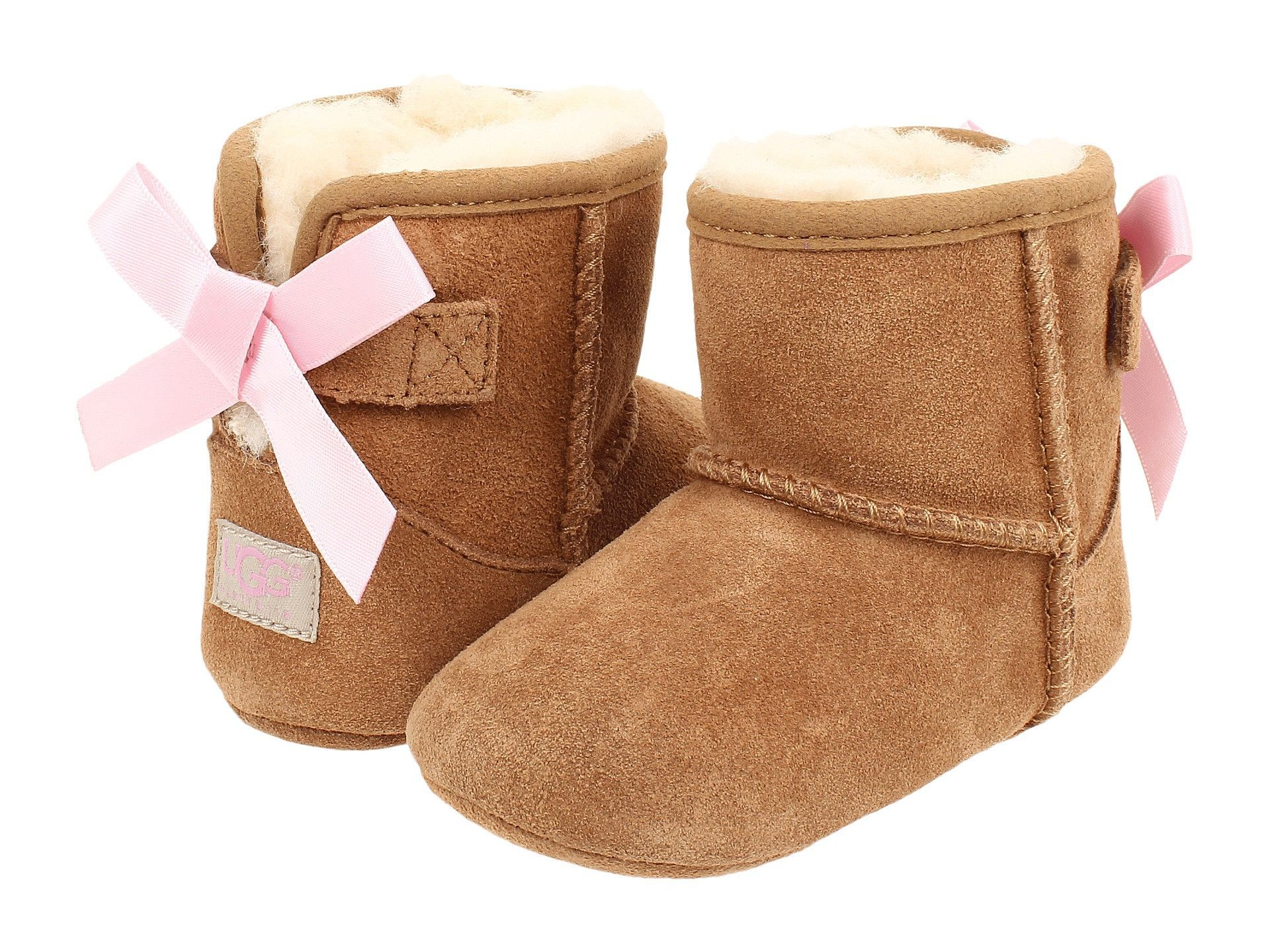 The Jesse Bow by Ugg in chestnut suede is lined in plush natural wool for foot-pampering comfort with a pink satin bow which adorably finishes this sweet ...