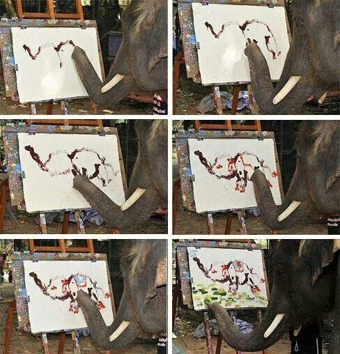 Elephant painting an elephant.