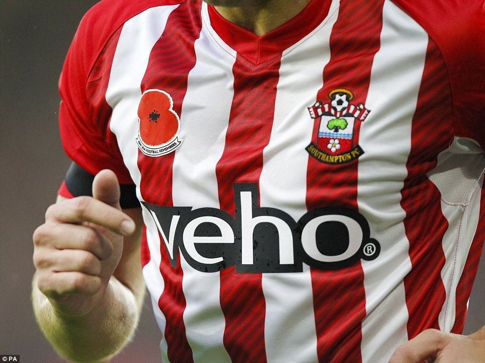 Both teams were wearing a special emblazoned poppy that bears the caption '1914-2014 Footb...
