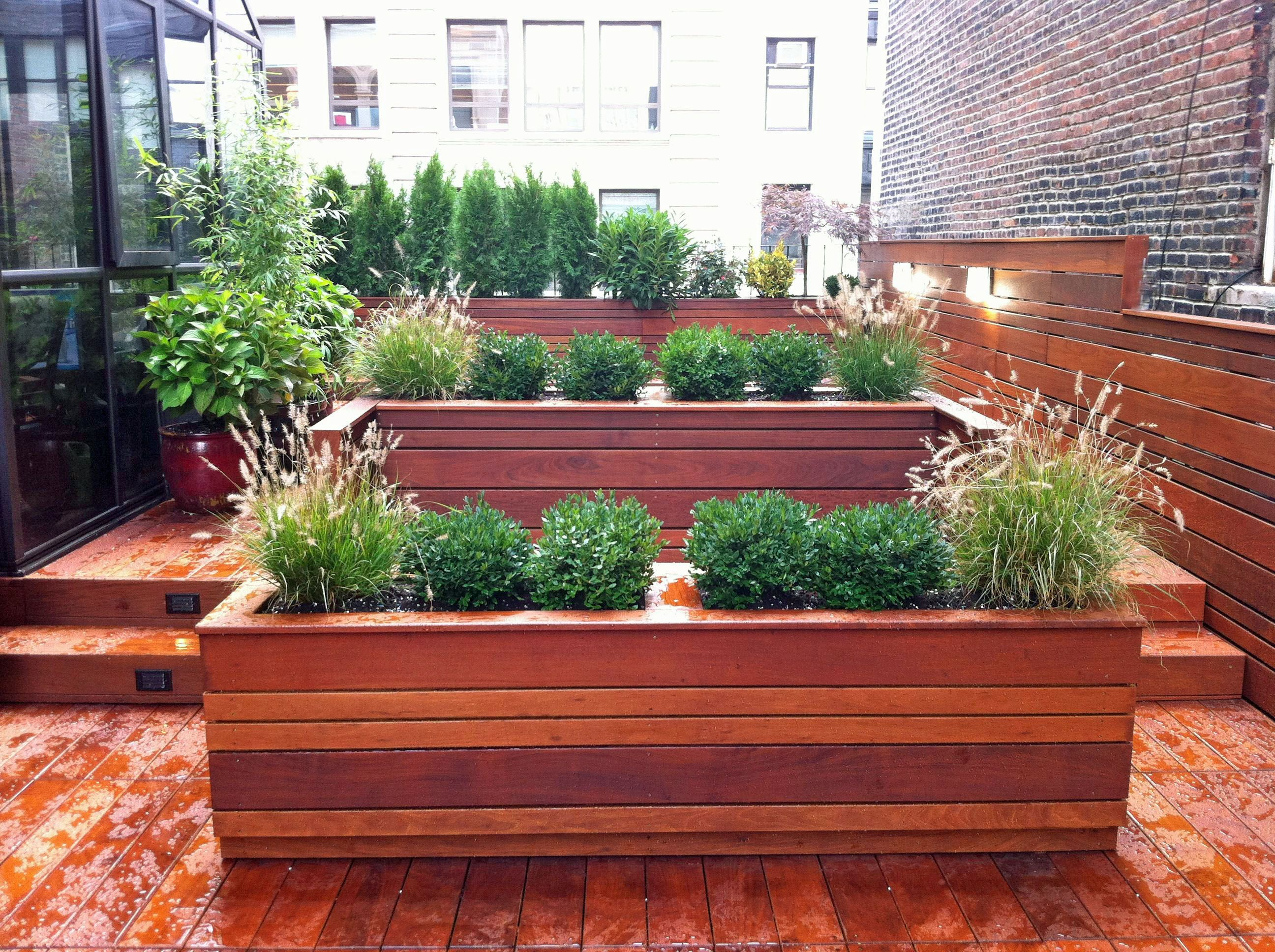 This nyc custom roof garden design features contemporary for Garden decking ideas pinterest