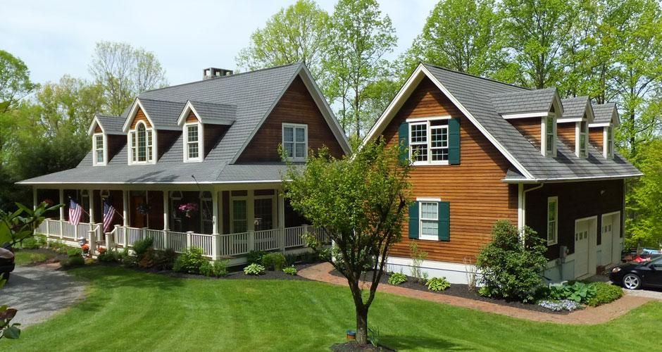 Traditional country home with wrap around porch in for Modern homes with wrap around porches