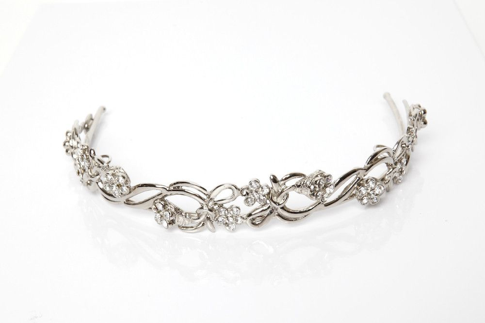 Priscilla: A medium sized bridal tiara. Petite crystal flowers gently grace intertwining smooth shiny vines. Silver plated metals.