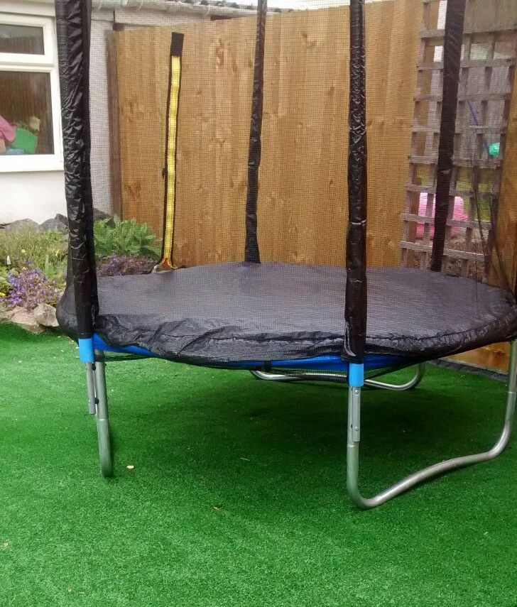 Putting Some Artificial Grass Under The Trampoline Makes The Garden Look More Attractive As Natural Grass Will Die Budget Garden Natural Grass Artificial Grass