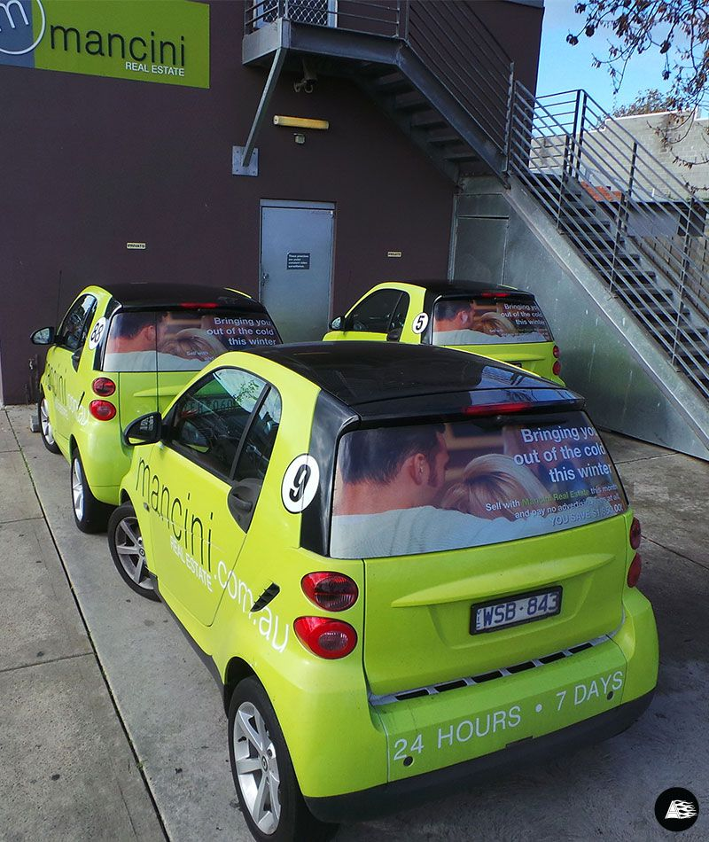 Real Estate Mancini Smart Car Vehicle Wrap Rear Window