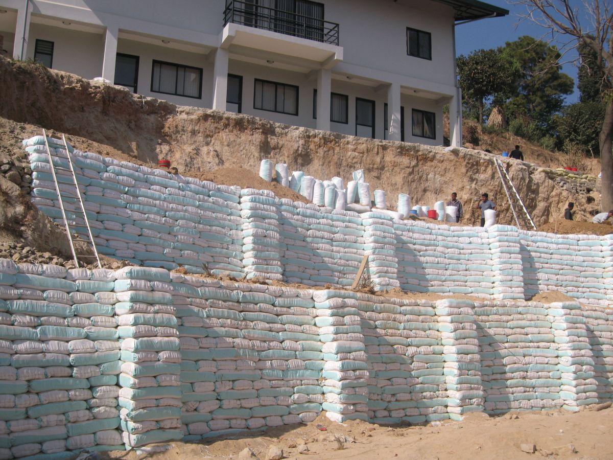 Earth Bag Retaining Wall In Binayak Bal School Blogs From Ecca Concrete Retaining Walls Retaining Wall Sloped Backyard