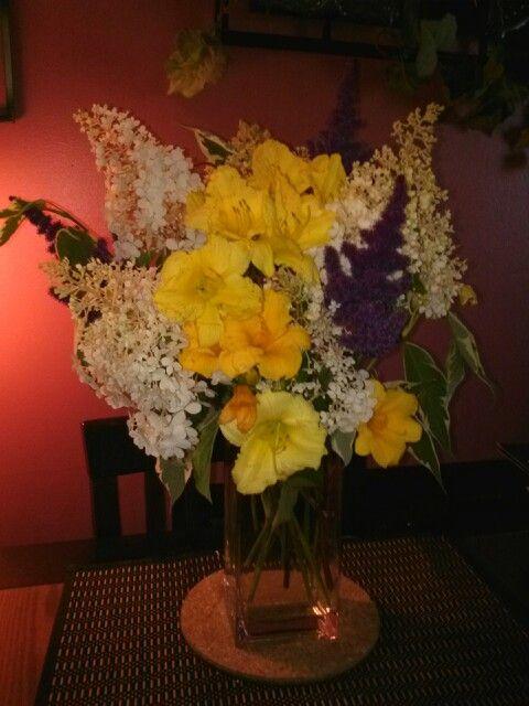Bringing sunshine in, handpicked from garden! Daylilies, hydrangeas, varigated weigela.