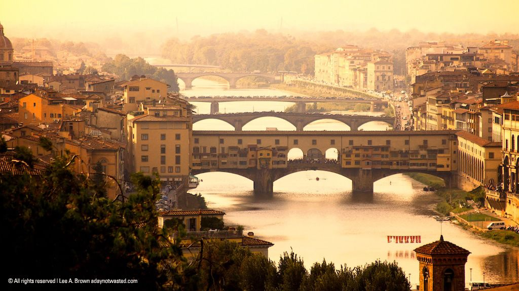 Italian Florence: View Of The Arno River And Ponte Vecchio In Firenze