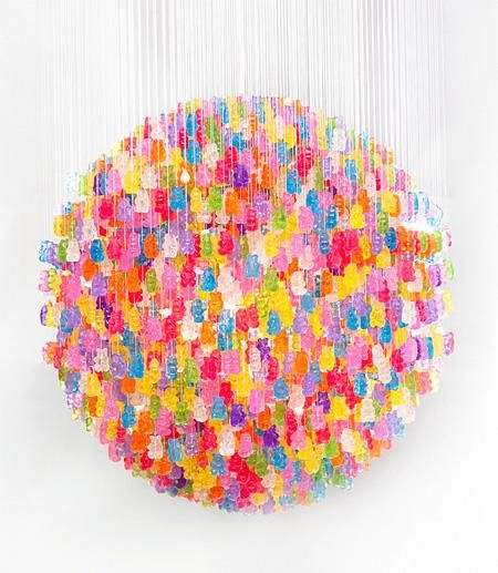 gummy bear chandelier - looks cool!  Not sure I'd use gelatin based candies for this (what about melt?), but lollipops perhaps by putting led lights into holes from stems...