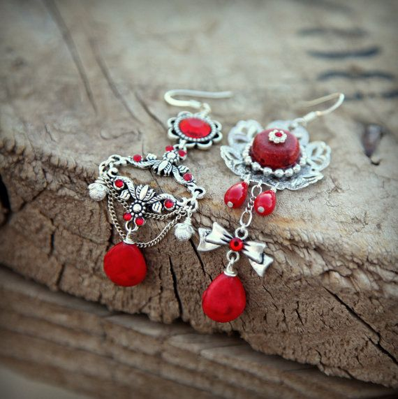 This pair of enchanting asymmetrical earrings will guarantee you feel just as bewitching as the fiery reds of the corals