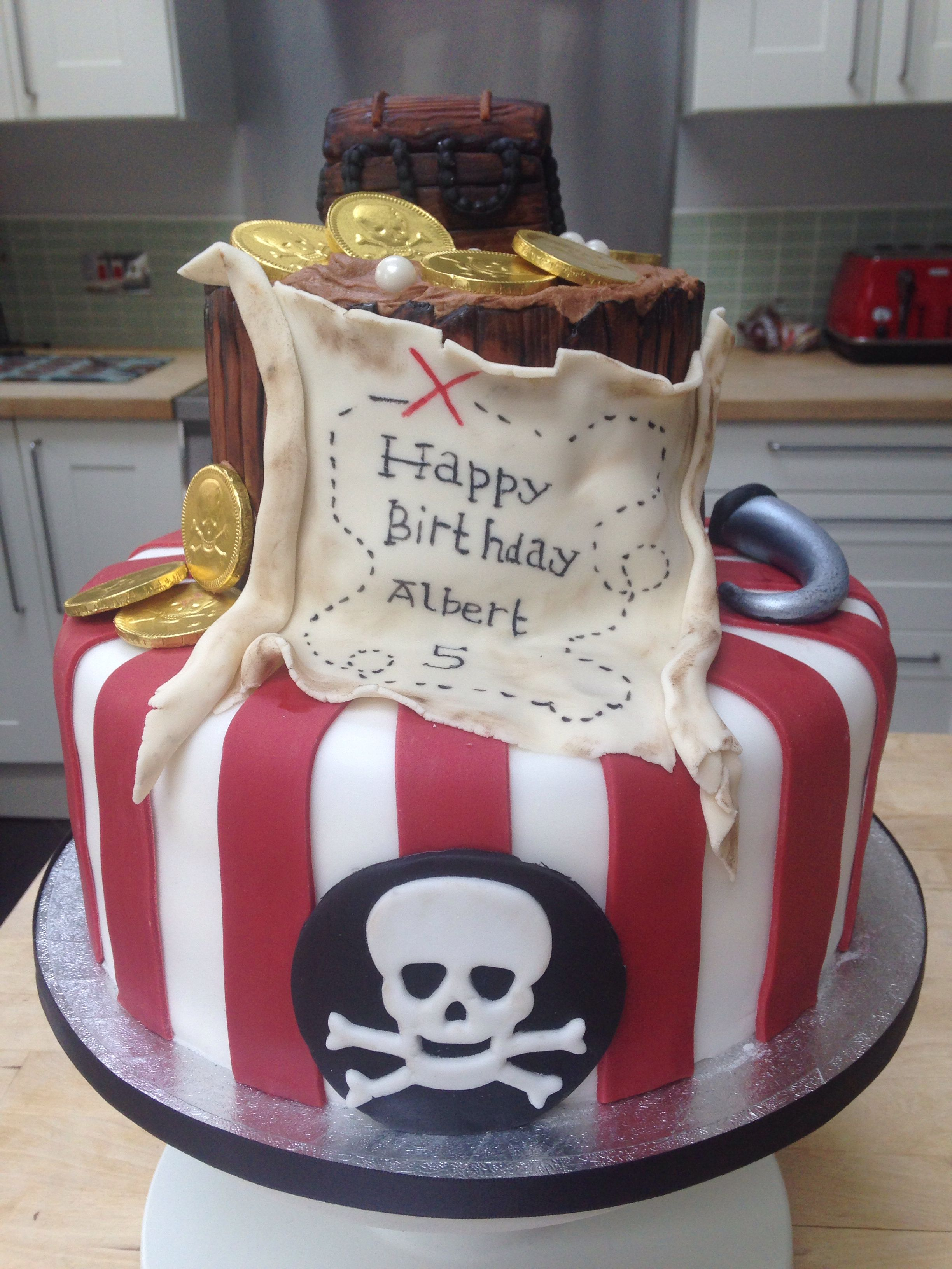 """Pirate themed cake. 10"""" vanilla with strawberry jam and vanilla buttercream filling and a 6"""" chocolate cake with chocolate buttercream filling x"""