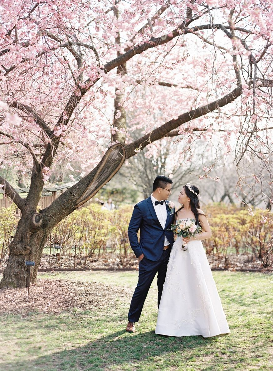 Bride and Groom by Cherry Blossoms at Brooklyn Botanic