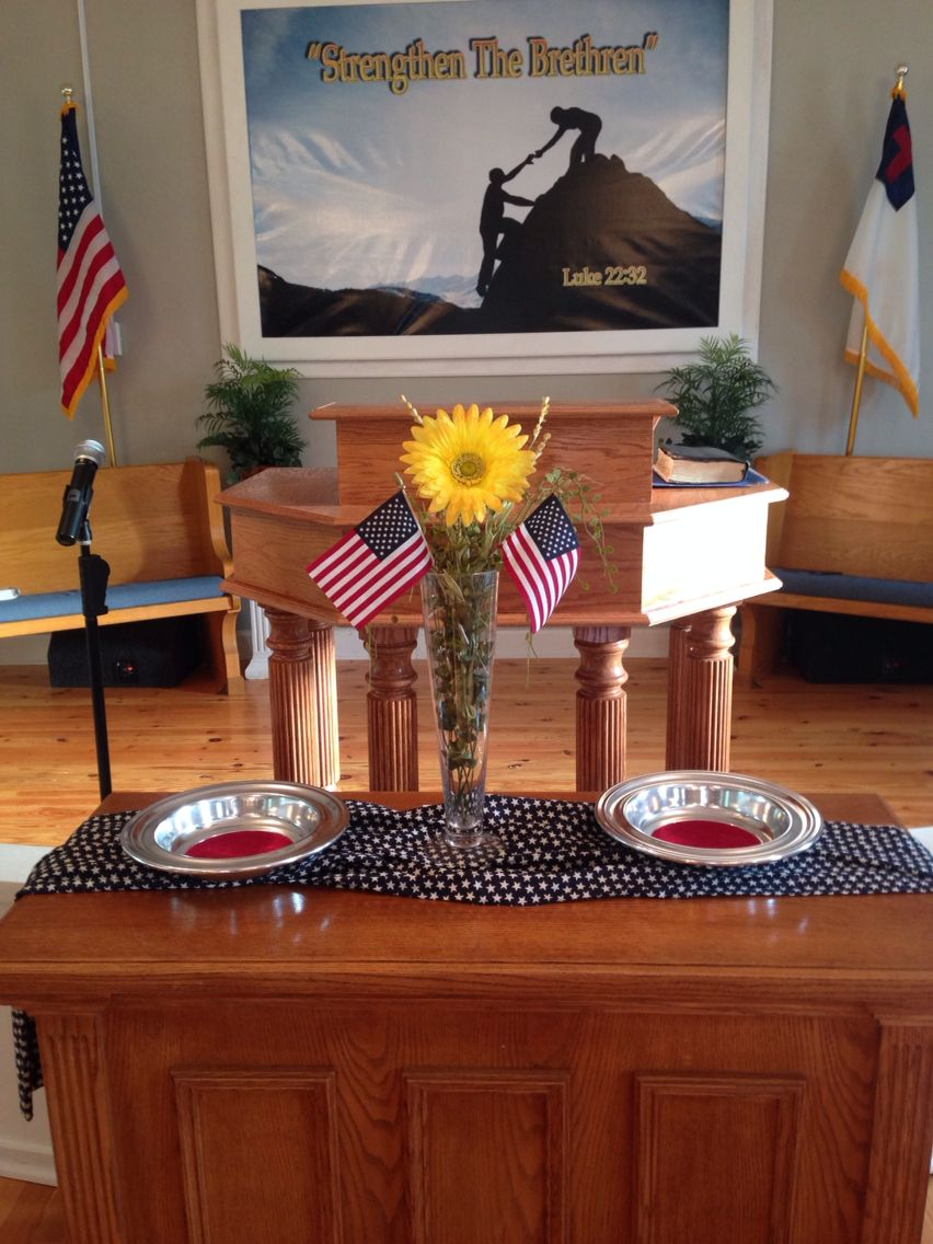patriotic church decorations. yellow flower and american flags for