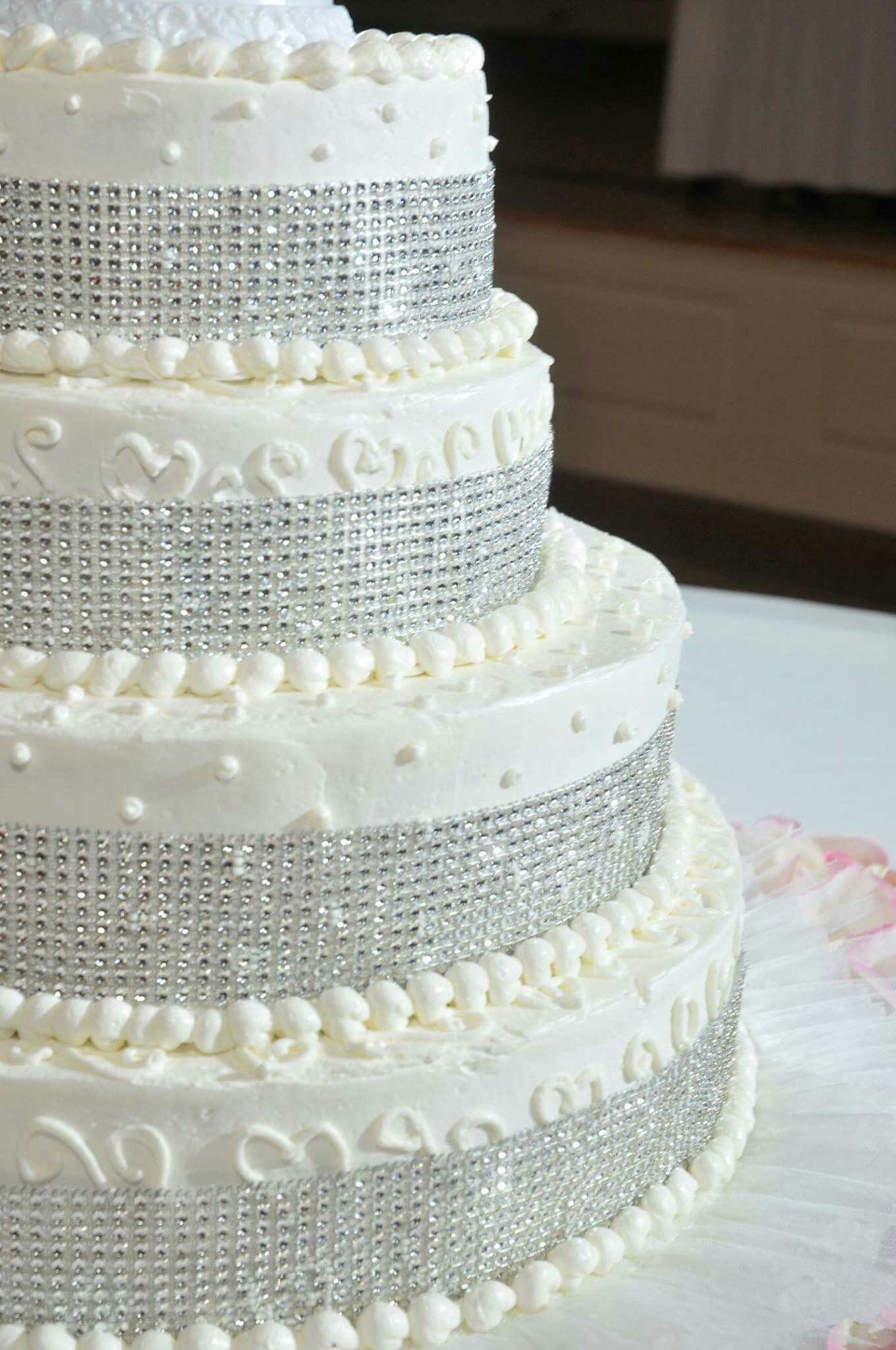 4tiered cake with sparkling silver ribbon surrounded by