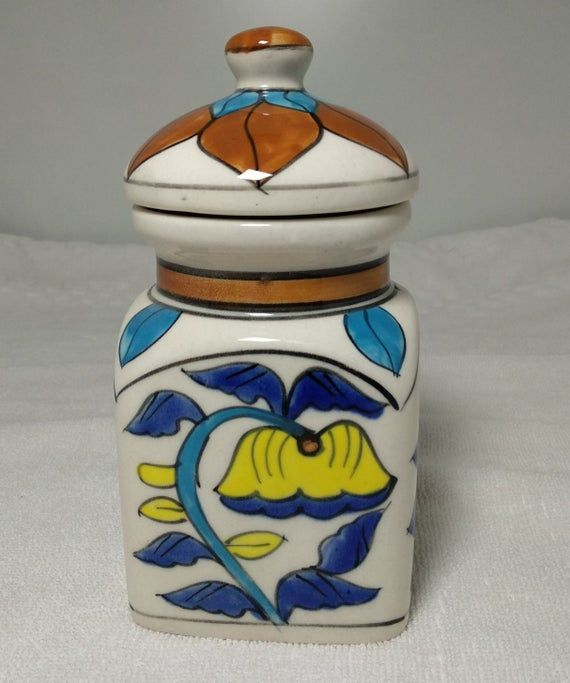 Ceramic Handpainted JarSize :Height 6' Inch ApproxLength & Width 3 * 3 InchNOTE : Please See the all photos for size. Thank youGive a decorative touch your kitchen storage Ceramic Jar! All our products are exquisitely handmade, one piece at a time, using natural made products. It is therefore quite difficult if not impossible to make identical items.Please note that as all items are painted by hand that there may be inconsistencies or slight imperfections.