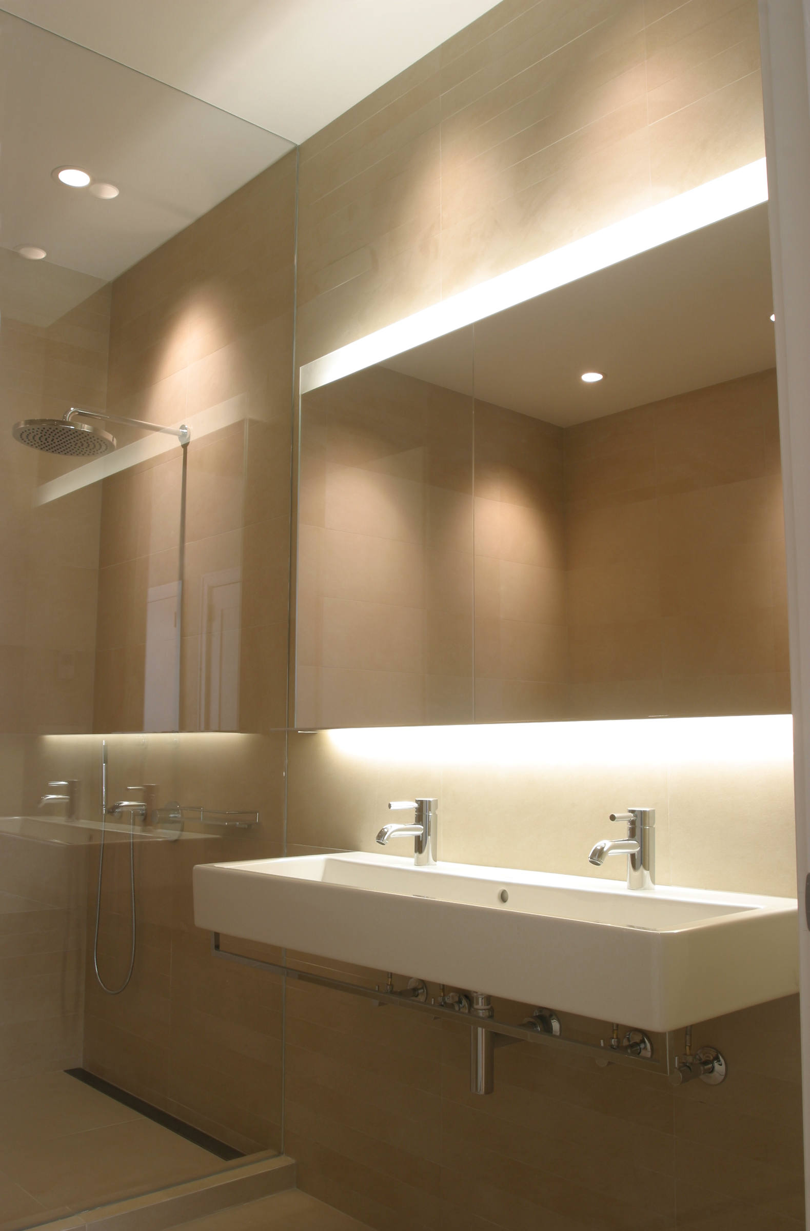 Bathroom With Custom Backlit Mirror, Polished Stainless Steel Shelf And  Wall Mounted Fittings.