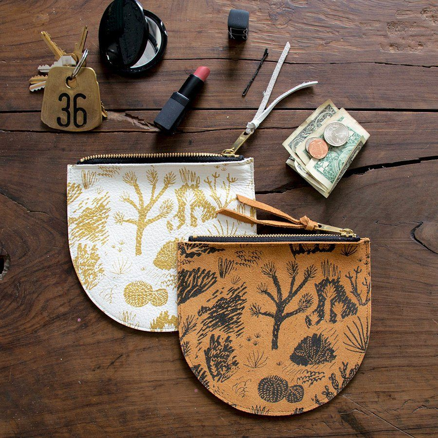 JOSHUA TREE ROUNDED LEATHER POUCH - Boxhill Keep smaller items in a safe place with BOXHILL's Joshua Tree Rounded Leather Pouch! This item is crafted from soft and luxurious leather, and it is accented with a brass zipper and a leather zipper pull.