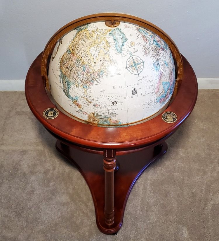 Situated on a fine walnut finish, this three leg globe is in almost perfect condition. Found unloved in corner of a dark thrift store, we brought the original finish back to life. This beautiful antique globe features the journey of Columbus. It was manufactured by at least 1991. Follow the link if you would like to buy this globe! #RefurbishedFurniture #AntiqueFurniture #FurnitureForSale #OldFurniture #RefinishedFurniture #Vintage #UpcycledFurniture #FurnitureMakeover