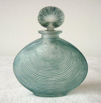 (via Pin by wild rose on blue | Pinterest)  René Jules Lalique | Telline bottle c.1920.