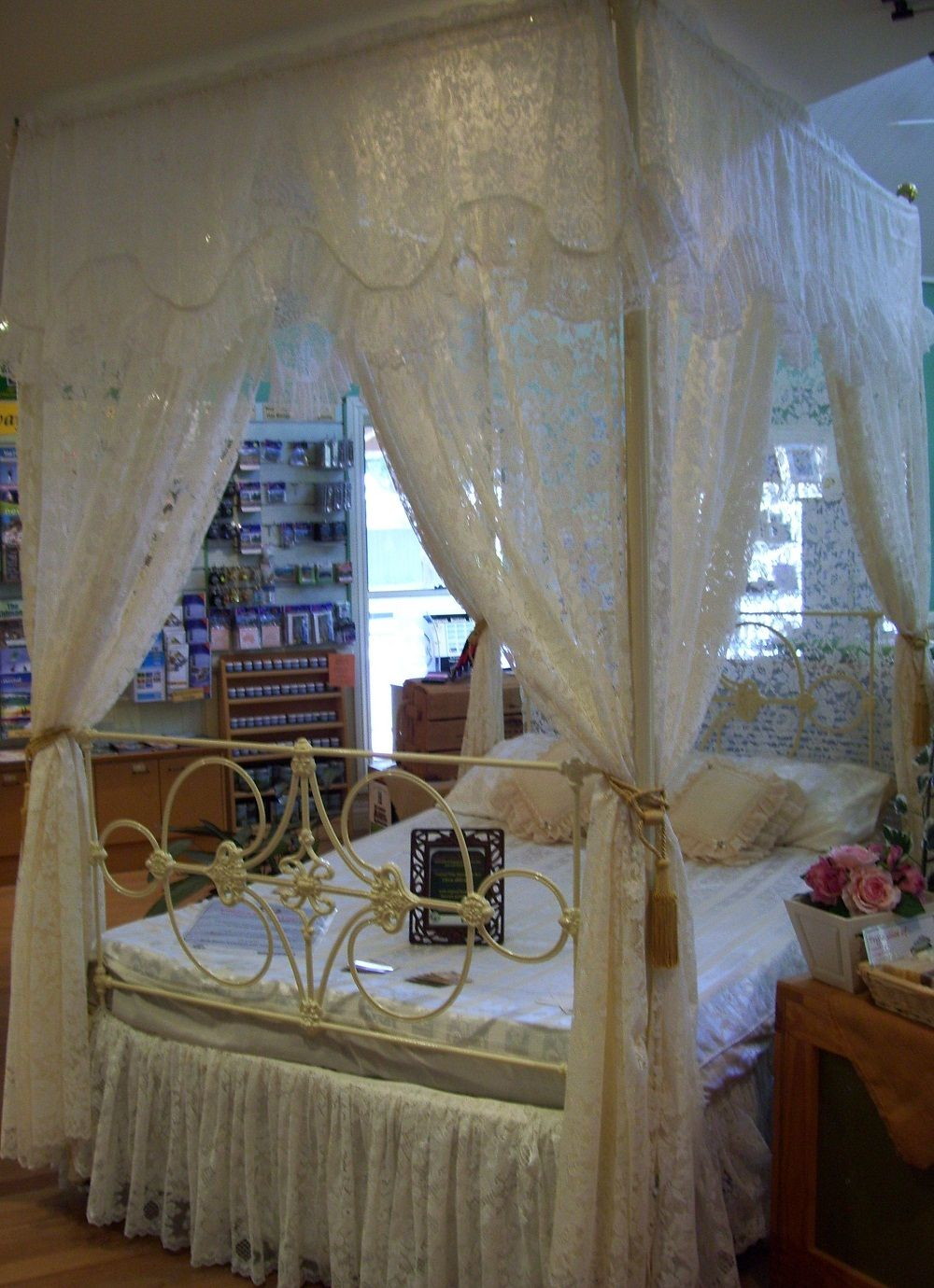 Circa 1860 to 1880 Four Poster, dressed in lace curtains