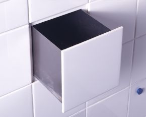 Hidden drawers in tile wall. Bathroom and kitchen.