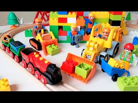 Fun video for kids. Construction workers are building a Lego Duplo ...