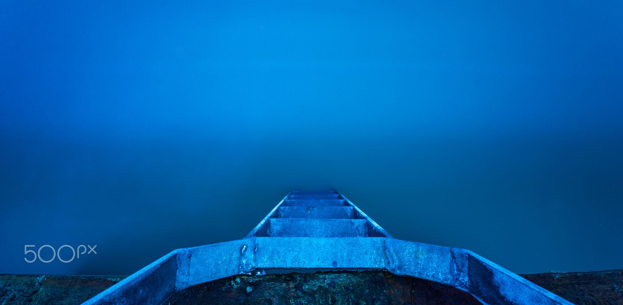 Into The Abyss - Very long exposure of a ladder leading into the Irish Sea at the high Rock in Portmarnock, Dublin in Ireland.