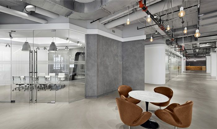 Industrial aesthetic office space in empire state building for Commercial office space design ideas