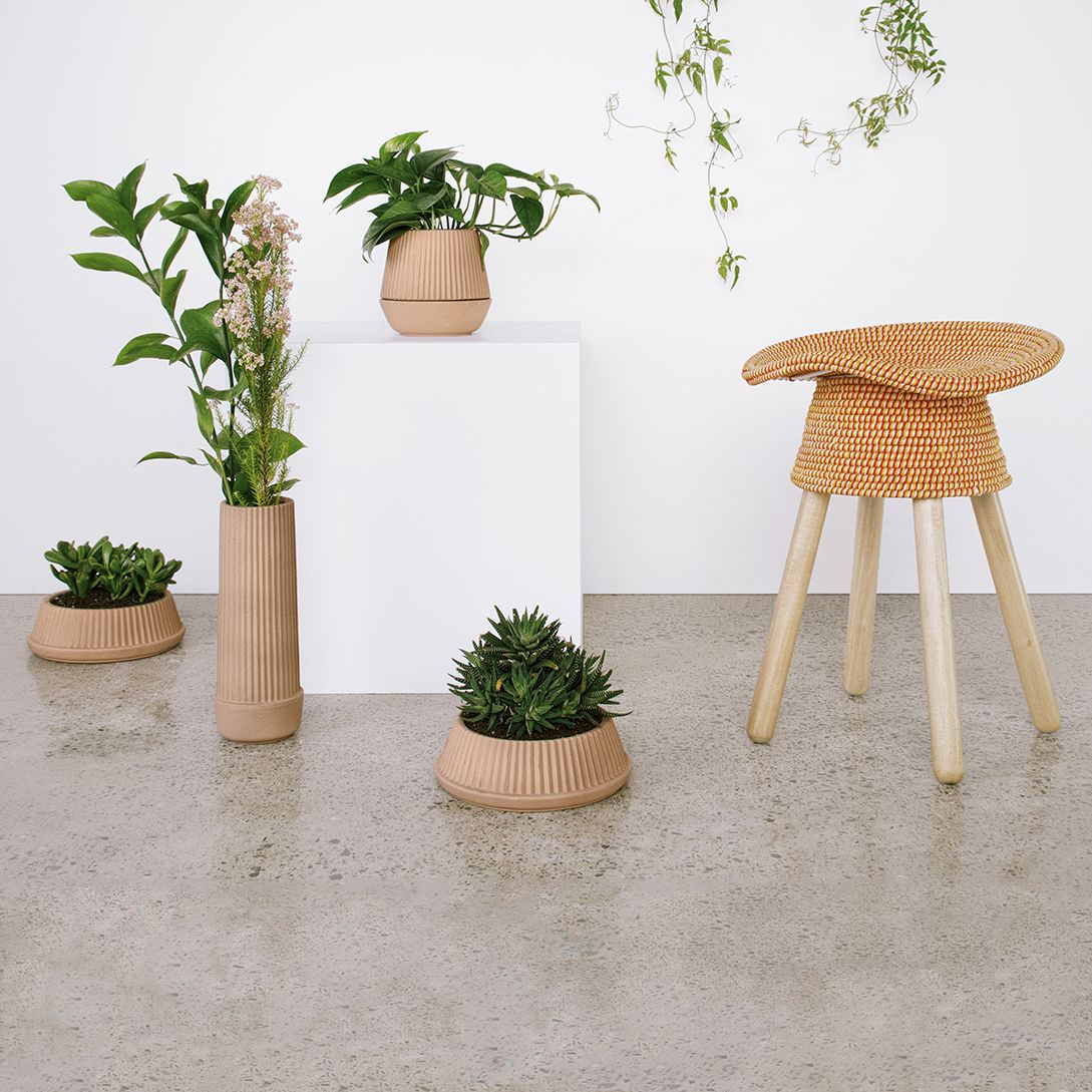 Pleated Planter Series designed by MSDS for Umbra Shift. The Pleated series was made to accompany a plant through different stages of growth. Each piece is handmade, sporting geometric pleats that beautifully highlight its contents. Planter includes a self-watering wick.