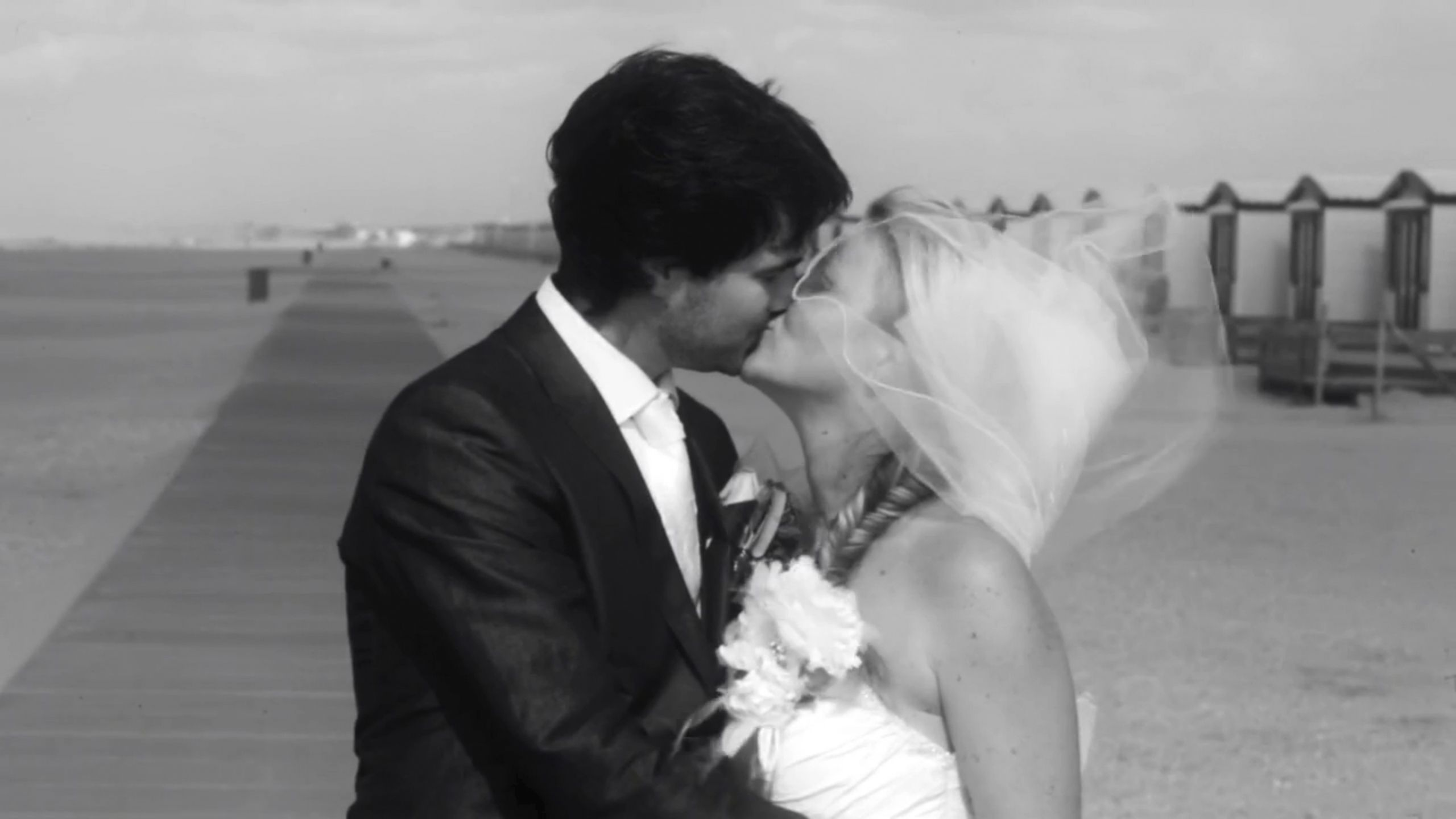 On a long stretch of beach, sealed with a kiss...