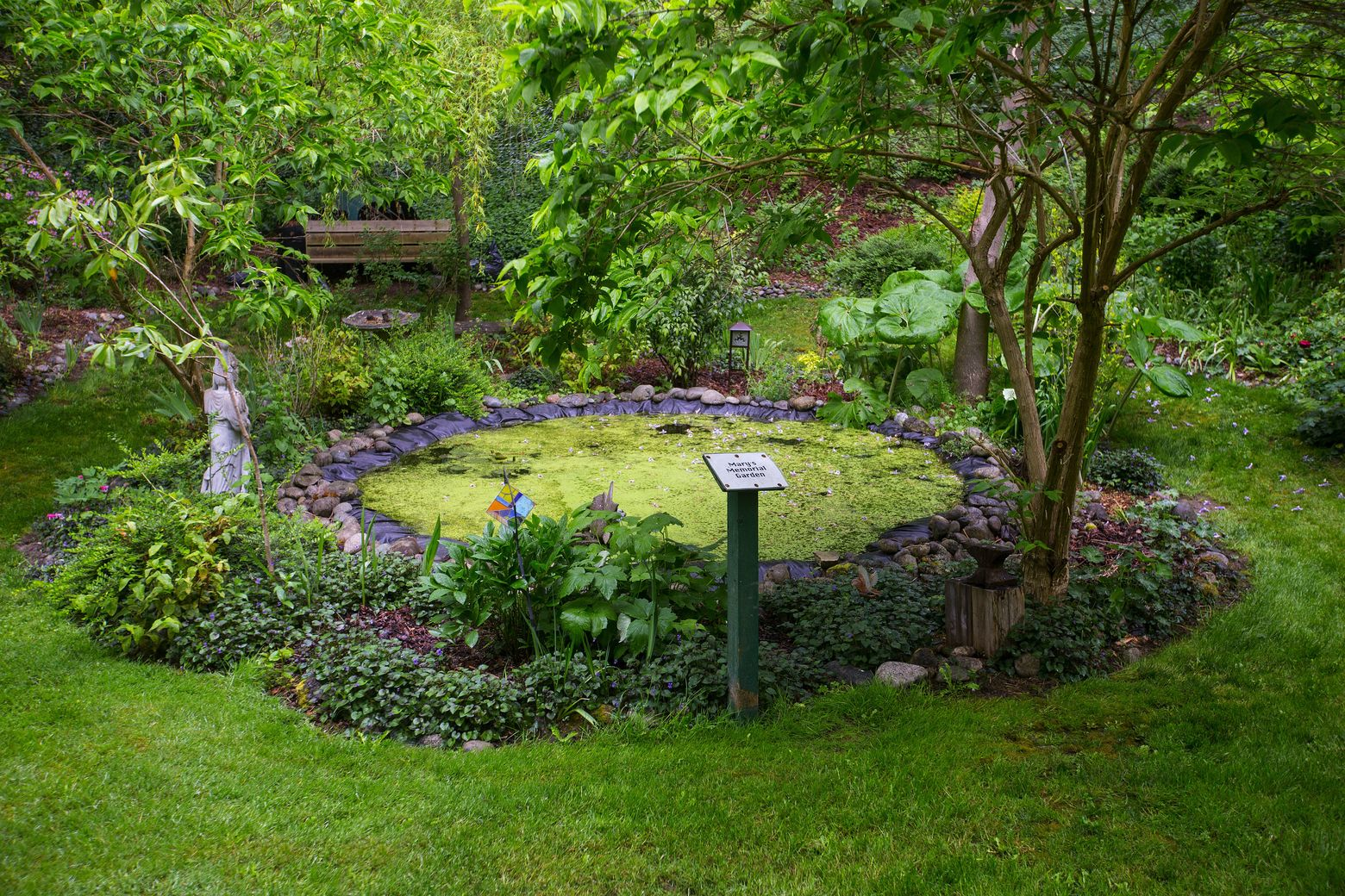 Pond. John and Marjie Bachert's Coupeville garden is designed around a giant kettle. (Mike Siegel/The Seattle Times)