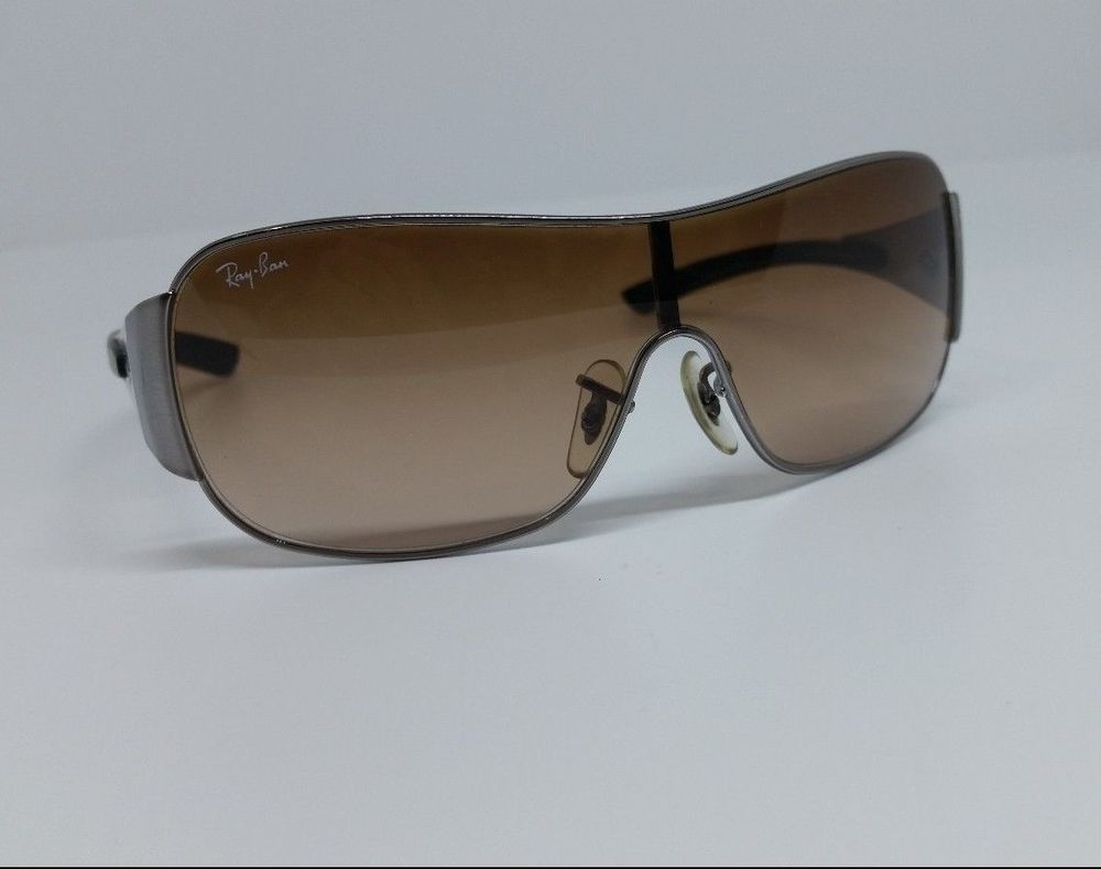 41603aab25 Ray-Ban Small Junior Sunglasses 9517s 200 13 Wrap Frame GUNMETAL brown  gradient